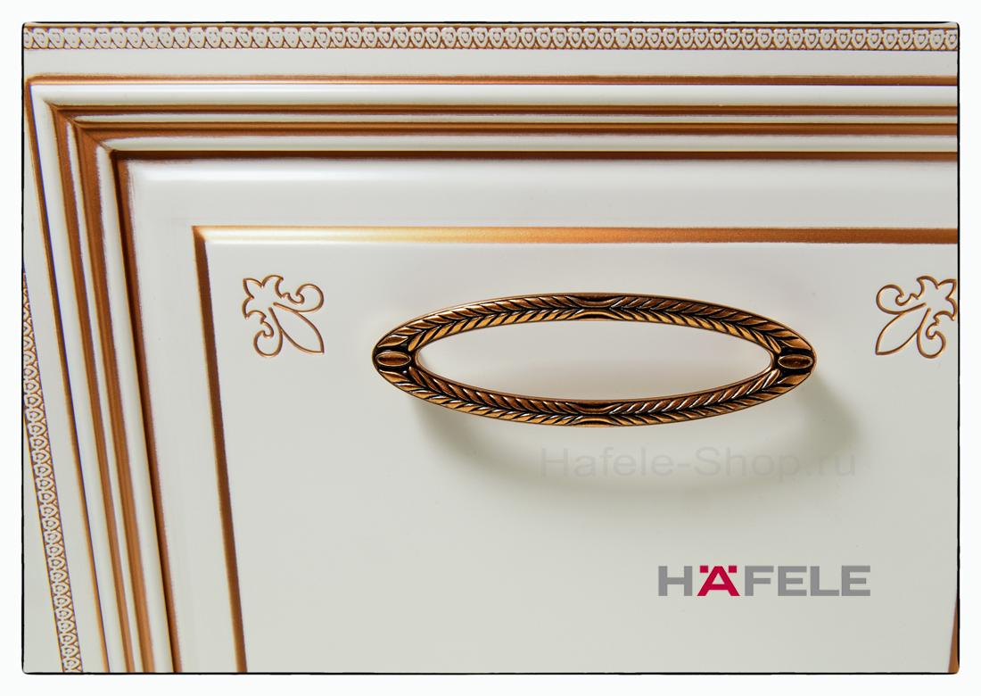 Ручка мебельная, цвет античное золото, длина 142 мм, между винтами 128 мм